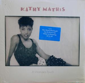 Album  Cover Kathy Mathis - A Woman's Touch on TABU Records from 1988